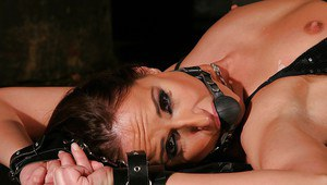 Sexy Kathia Nobili pushes a dildo into a tied up Andy Brown