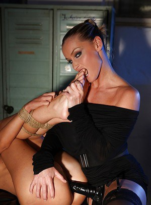 Stunning mistress is humiliating a girl with a big strapon