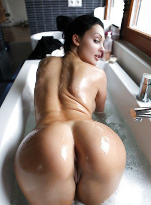 Stunning babe Aletta Ocean takes a bath and pleases her cunt with toys