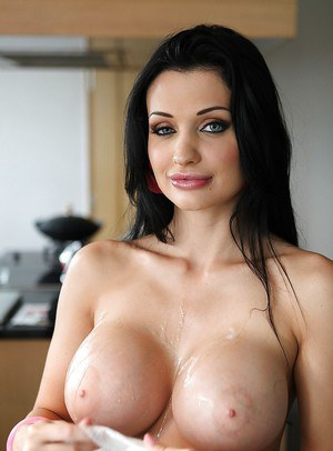 Busty pornstar with a sexy ass Aletta Ocean gets ready for a shoot