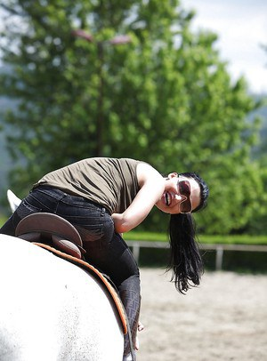 Pornstar Aletta Ocean is riding a horse outdoor in glasses