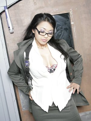 Asian babe Mika Tan pose in lingerie and exposes pussy in the office