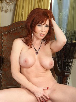 Redhead MILF with big tits Brittany O'Connell touches her spread pussy