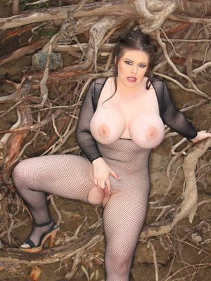Chubby babe in pantyhose Daphne Rosen shows her big butt outdoor