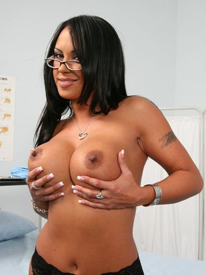 Horny doctor Mariah Milano shows her lingerie and her big tits