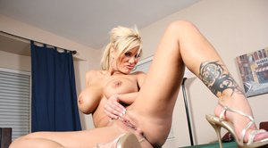 Filthy wife Shyla Stylez takes off her jeans to pose naked solo