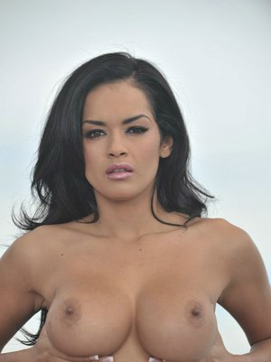 Busty babe Daisy Marie strips off panties and bra outdoor