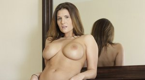 Milf in fishnets squirts on huge dildo