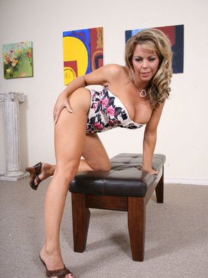 Busty MILF Amber Lynn Bach shows her butt and her fuckable vagina