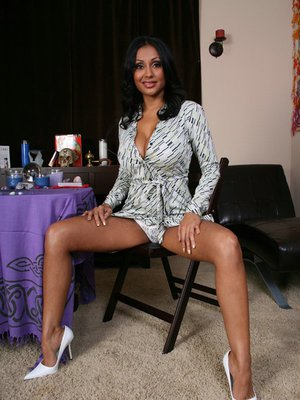 Sexy Indian MILF Priya Anjeli Rai is posing naked with her cunt spread