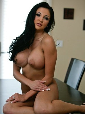 Busty wife Audrey Bitoni poses solo to show her big juggs