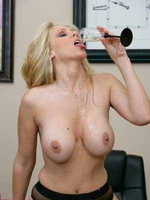 Mature babe Julia Ann stripping and spreading pussy in the office