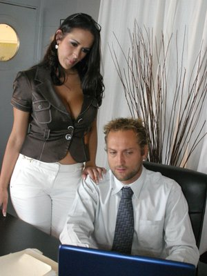 MILF babe with huge juggs Carmella Bing playing with a cock in office