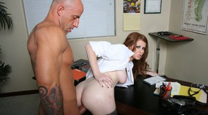 MILF babe Nikki Rhodes strips off uniform and enjoys ass fucking