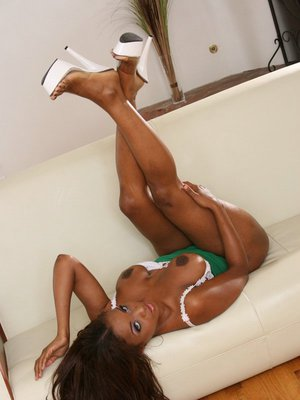 Big titted ebony MILF Sinnamon Love shows her hot ass and pussy