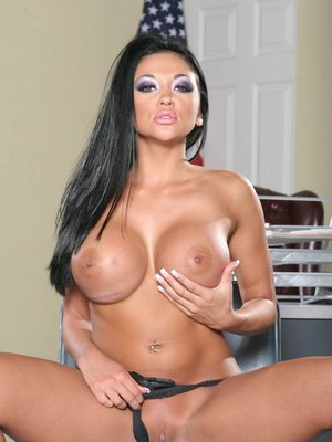 Sexy schoolgirl  Audrey Bitoni strips to her shorts and shows pussy