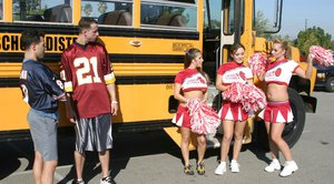 Three slutty cheerleaders starting a fervent orgy in the school bus