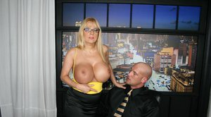 Big titted blonde in glasses Harmony Bliss bouncing on a huge dick