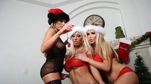 Three insanely sexy babes celebrating Xmas with some hot lesbian sex