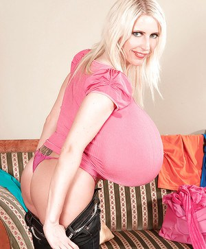 Mature blonde in tight jeans Beshine showing her extremely huge juggs