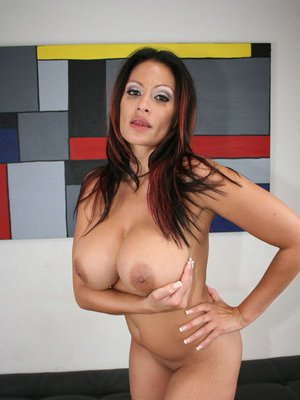 Latina MILF Ava Lauren stripping nude and showing her smashing curves