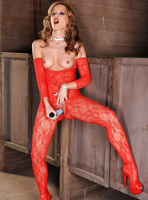 Glamorous pornstar in red lace bodystockings getting off with a dildo