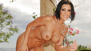 MILF pornstar Dylan Ryder strips and demonstrates her booming tits