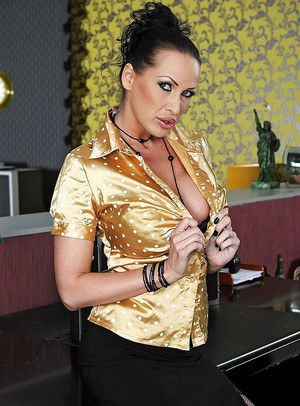 Raunchy MILF pornstar strips to stockings and shows big boobs at work