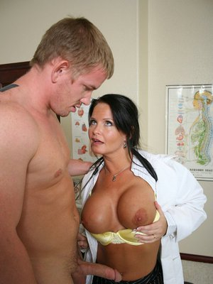 Busty doctor in uniform Megan Monroe bouncing on her patient's dick
