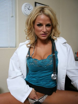 Sizzling MILF in doctor uniform showing off her goodies in the office