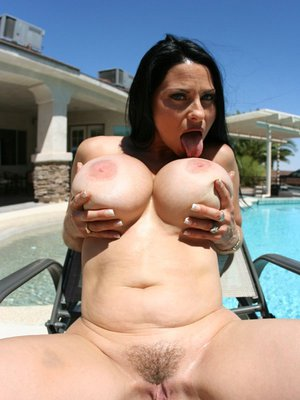Raunchy MILF Harley Rain revealing her boobs from bikini at the pool