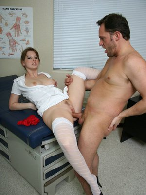 Sexy doctor Sunny Lane in uniform strips for hot fucking