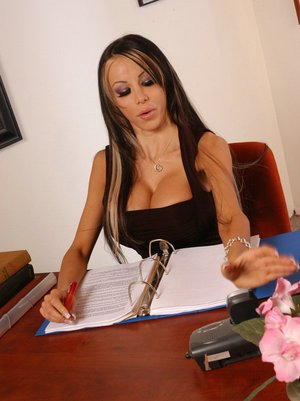 MILF Danielle Derek with big tits spreading her pussy in the office