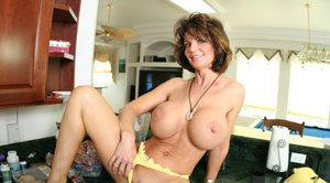 Mature yet sexy Deauxma with big boobs poses in hot panties