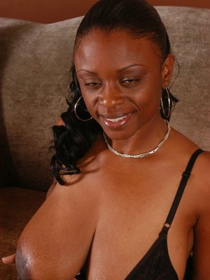 Ebony MILF with big juggs Lola Lane shows her tits and masturbates