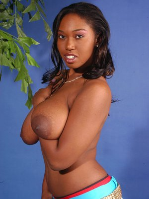 Ebony MILF babe Delotta Brown shows her tits with big nipples