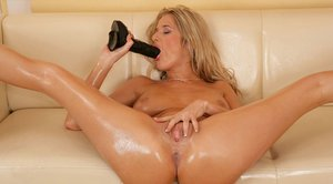 MILF babe Jane Darling pushing a huge dildo in her butthole