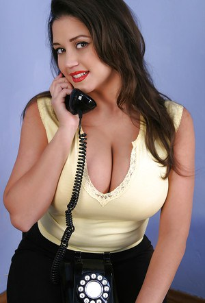Sexy babe with huge boobs talks on the phone in a hot outfit