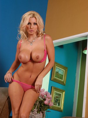 MILF babe with big tits Brittany Andrews gets naked and spreads pussy