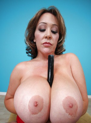 Mature Kandi Kox spreading her pussy and fondling her big tits