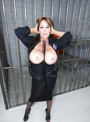 Busty mature babe Kandi Kox strips off uniform to tease her tits