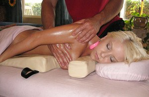 Young babe Tessa Taylor licking balls as a praise for a good massage