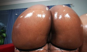 Fatty ebony MILF babes Sky and Cali exposing their massive butts
