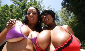Ebony MILF babes with big tits Janae and Stacy posing naked outdoor