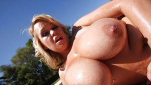 Chubby MILF babe Brandy Talore shows her huge boobs outdoor