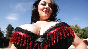 Big titted Latina babe Julia Juggs spreading her thighs to show pussy