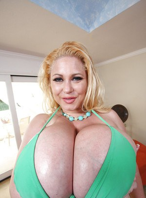 Busty MILF babe Samantha 38G shows her melons in a fishnet shirt
