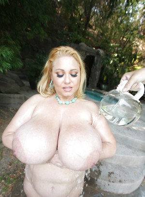 Big titted MILF babe Samantha 38G drops whipped cream on her boobs