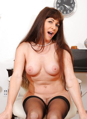 Busty mature Alexandra Silk gets horny toying her hairy cunt