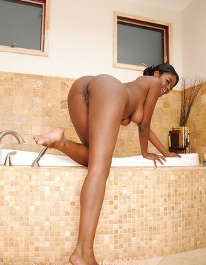 Ebony babe Jenna Brooks with big tits strips naked in the shower